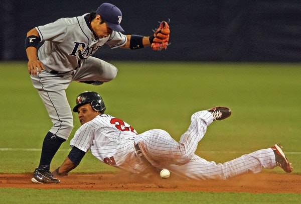 Carlos Gomez is safe at second wih his eighth stolen base of the season beating the throw to Rays second baseman Akinori Iwamura on April 16.