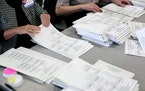 Ramsey County election officials counted ballots into piles of 25.
