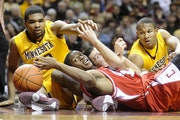 Ralph Sampson III, left, hit the floor against Cornell as a sophomore, along with Blake Hoffarber and Lawrence Westbrook.