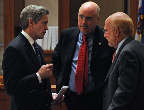 Norm Coleman and his attorneys Fritz Knaak, center, and Ben Ginsberg talked strategy during a break in the action Tuesday.