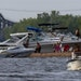 """Still worth a visit, for now: Boaters established camp on a site nicknamed """"Beer Can Island"""" across from Hudson, Wis. """"A lot of people live ecol"""