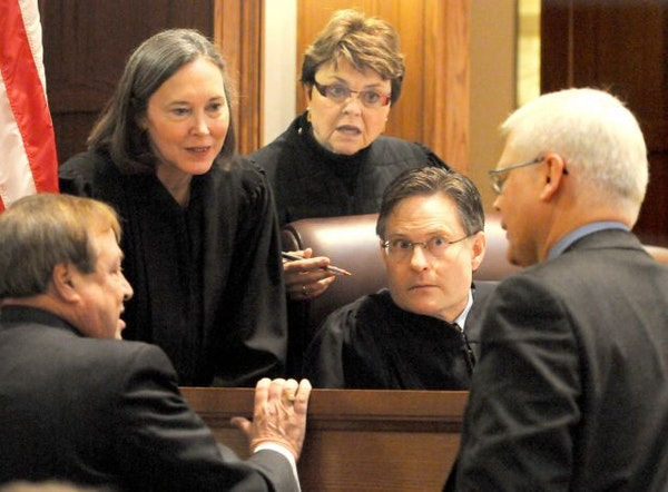 From left, the U.S. Senate election recount trial's three-judge panel, Denise Reilly, Elizabeth Hayden and Kurt Marben, listened while Joe Friedberg
