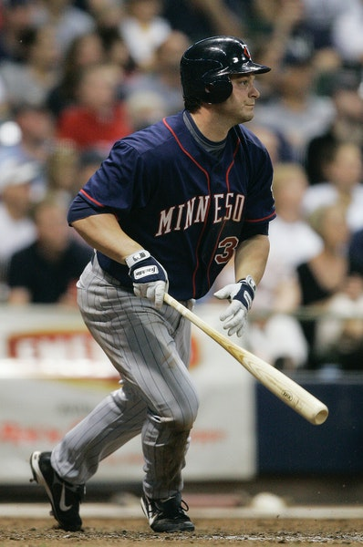 Minnesota Twins' Brian Buscher hit his a two-RBI scoring single during the 12th inning Saturday in Milwaukee.