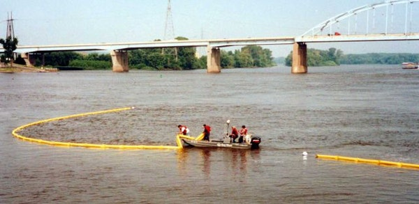 A Bay West crew deployed a containment boom during a training exercise on the Mississippi River. The company shipped similar booms to the Gulf Coast l