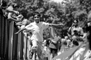 Rohan Mittra, 6, spreads his arms and makes like a bird as he runs into Lake Country School and upstairs as his father Rob Mittra, rear, photographs t