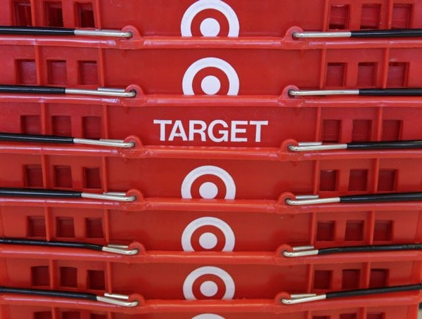 FILE - In this May 20, 2009 file photo, shopping baskets are stacked at a Chicago area Target store. Lean inventory and stronger-than-expected holiday