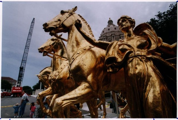 Minnesota State Capitol (St. Paul) / Spectators were able to get a close look at the front of the Quadriga sculpture after it was lifted off the Capit