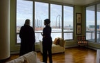 Holly Holt showed a third-floor condo on Friday to Karen Elshazly of Orono. The Zenith Condominium, on S. 2nd Street near the Guthrie Theater, overloo