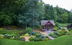 With 30 garden beds spread over 11/2 acres in Lake Elmo, Chris and Jim Trevis garden on a grand scale — and play host to a wide variety of wildlife.