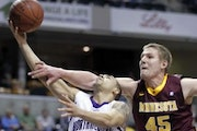 Colton Iverson, at right, is leaving the Gophers men's basketball team.