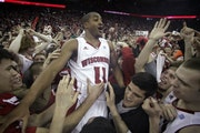 In happier times, Jordan Taylor celebrated with fans after beating then-undefeated No. 1 Ohio State 71-67 in February.