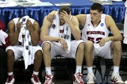 Wisconsin's Jordan Taylor (11), Jon Leuer and Keaton Nankivil (52) reacted on the bench near the end of the Badgers' Sweet 16 loss to Butler.