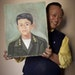 Dai Vinh held a portrait based on his South Vietnamese army ID from about 1969.