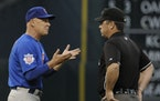Chicago Cubs manager Mike Quade, left, argues with second base umpire Rob Drake after Houston Astros' Bill Hall evaded a tag in the first inning of a