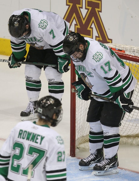 From left, North Dakota's Danny Kristo, Carter Rowney and Jason Gregoire at the end of Thursday's game.