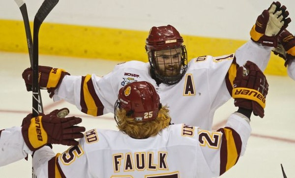 Justin Faulk celebrated with Minnesota Duluth teammate Jack Connolly after Connolly's goal against Notre Dame.