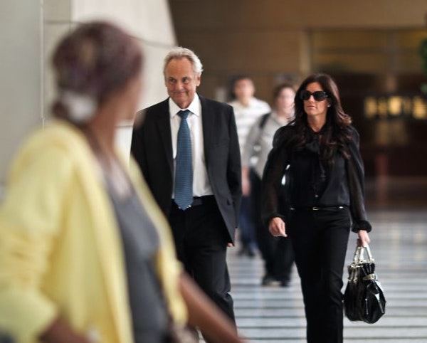 Denny Hecker walked with Christi Rowan, then his girlfriend, as he left federal court in Minneapolis in 2010.