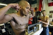 Caleb Truax, left, and Andy Kolle weighed in Thursday in Coon Rapids before Friday's fight.