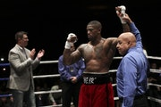 Referee Joe Cortez held up the arm of Ray Edwards after he was declared the winner of his professional debut Friday night.