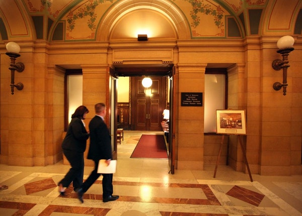 Majority Leader Amy Koch and House Speaker Kurt Zellers entered the governor's office for discussions.