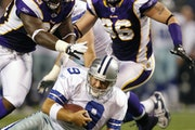 Dallas Cowboys quarterback Tony Romo was sacked by Minnesota Vikings defensive tackle Christian Ballard