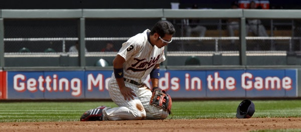 Shortstop Tsuyoshi Nishioka fell to the dirt chasing a ground ball in the hole in the third inning Sunday. But he was able to throw to second base for