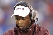 Former Gopher DeWayne Walker has a 5-21 record since taking the New Mexico State coaching job in 2008.