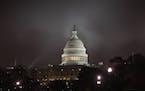 Fog envelopes Capitol Hill in Washington