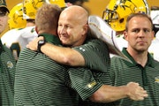 North Dakota State coach Craig Bohl, center, celebrated with assistants after the Bison defeated the Gophers in 2007. The teams meet again Saturday ni