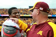 Miami's Jeff Tanner (74) congratulated Gophers coach Jerry Kill on the field after Saturday's game.