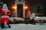 Jim Shaughnessy clears his walkway of the overnight Christmas snow at first light to prepare for the arrival of relatives at his home in Louisville, K