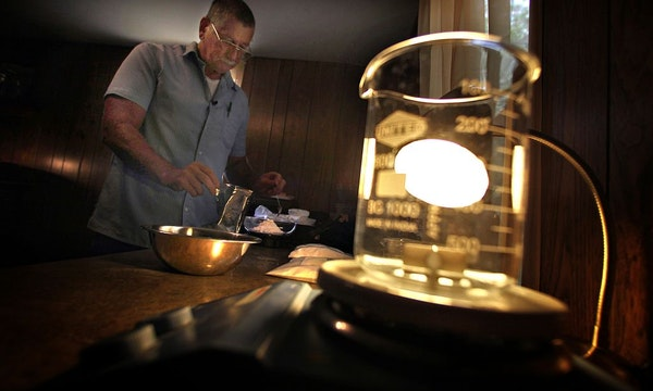 Light shined through a beaker in the mobile home that Rodger Seratt used to house the laboratory where he mixes synthetic drugs that include bath salt