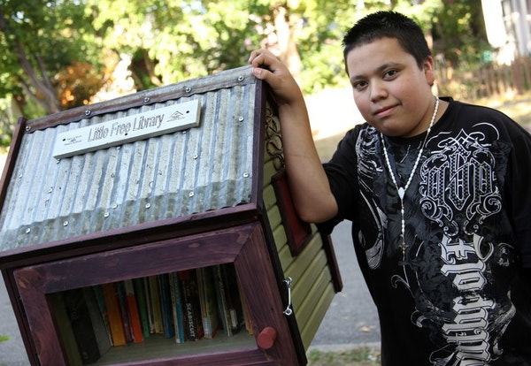 Pedro Garcia, 14, built the Little Free Library box that stands outside Sage Holben's St. Paul home.
