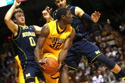 Gophers junior forward Trevor Mbakwe tried to find an open man against a Michigan double team.
