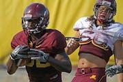 Gophers running back Lamonte Edwards (left)