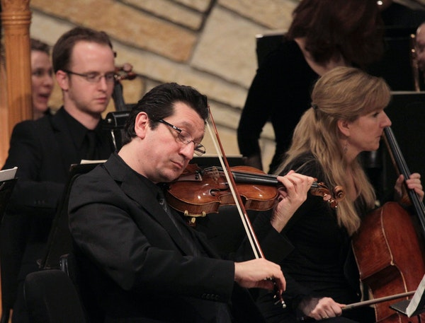 Ruggero Allifranchini, associate concertmaster of the St. Paul Chamber Orchestra, plays at a concert held at Trinity Lutheran Church in Stillwater, Mi