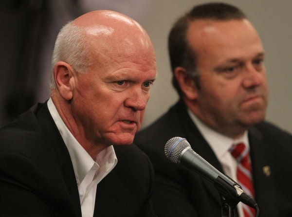 Twins interim General Manager Terry Ryan spoke to reporters after Twins President Dave St. Peter (right) announced Bill Smith would not return as gene