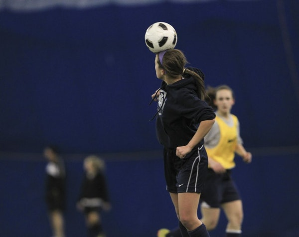 Shannon Wynne headed the ball during practice with her Minnesota Thunder Club Thursday night, January 12, 2011 at the Holy Angels Star Dome in Richfie