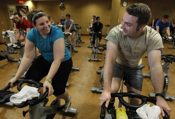 Couples who work out together; Ann Freeman, 29, and Jay Freeman, 27 at the Lifetime fitness Studio spin class last week.