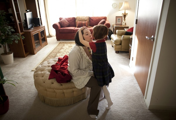 Single mom Kate-Madonna Hindes hugged her daughter, Ava, at their Chaska home before leaving to start her new job.