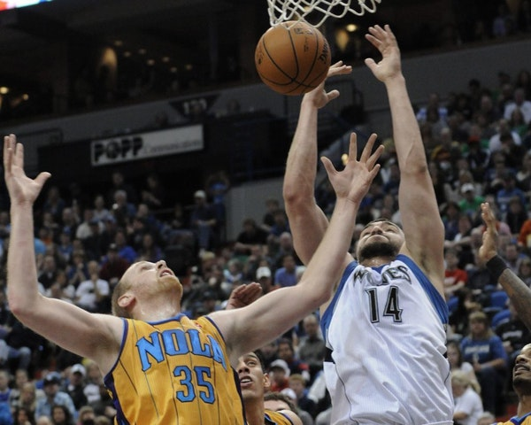 New Orleans Hornets' Chris Kaman, left, and Minnesota Timberwolves' Nikola Pekovic, of Montenegro, compete for the rebound in the first half of an NBA