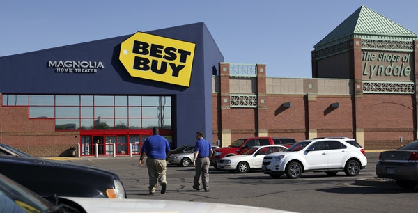 Best Buy employees walked through the parking lot and to the Best Buy store Thursday in Richfield.