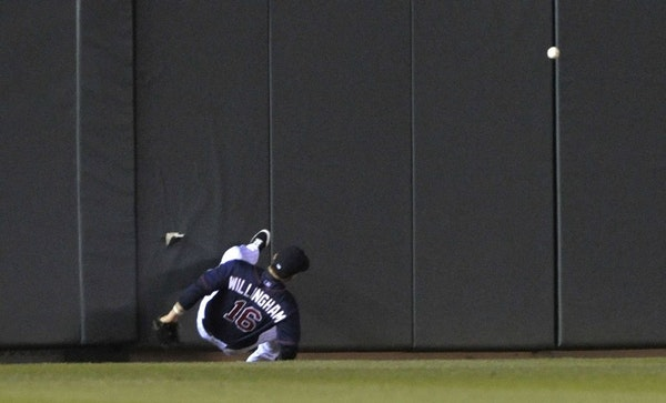 Twins left fielder Josh Willingham crashed into the wall at Target Field, trying to catch what turned into an inside-the-park, three-run home run by t