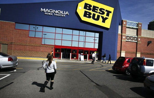 Shoppers head to and from the Best Buy in Richfield, MN, Thursday, March 28, 2012.