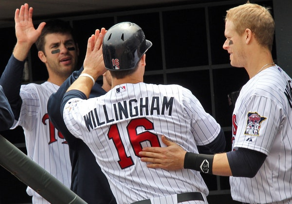 TWINS vs. Kansas City Royals. Twins won 7-4. Twins Josh Willingham had a big day offensively, was congratulated by teammates after scoring a run in th