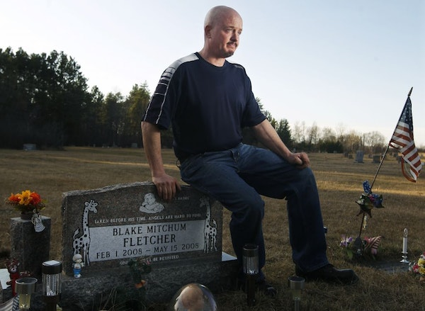 Robert Fletcher visited his son's grave. Blake, bottom left, died sleeping facedown in a day-care playpen.