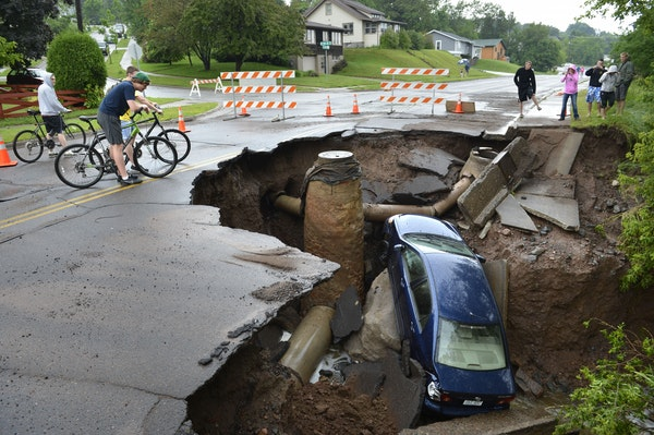 With over 9 inches of rain overnight and into Wednesday morning in Duluth Washouts, sinkholes and mudslides have taxed area roads. Many government bui