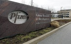 A Friday, March 2, 2012 photo shows the exterior of Pfizer in Groton, Conn. Pfizer Inc. Shares of Pfizer Inc. and Bristol-Myers Squibb Co. fell Monday