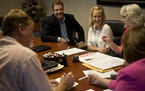 Homeowner Dana Johnson was all smiles on Friday as she finished the paperwork to sell her Minnetonka house with her agent, Judd Sampson, and seller re