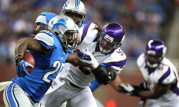Lions running back Mikel Leshoure is pursued by Vikings defensive end Brian Robison Sunday at Ford Field.